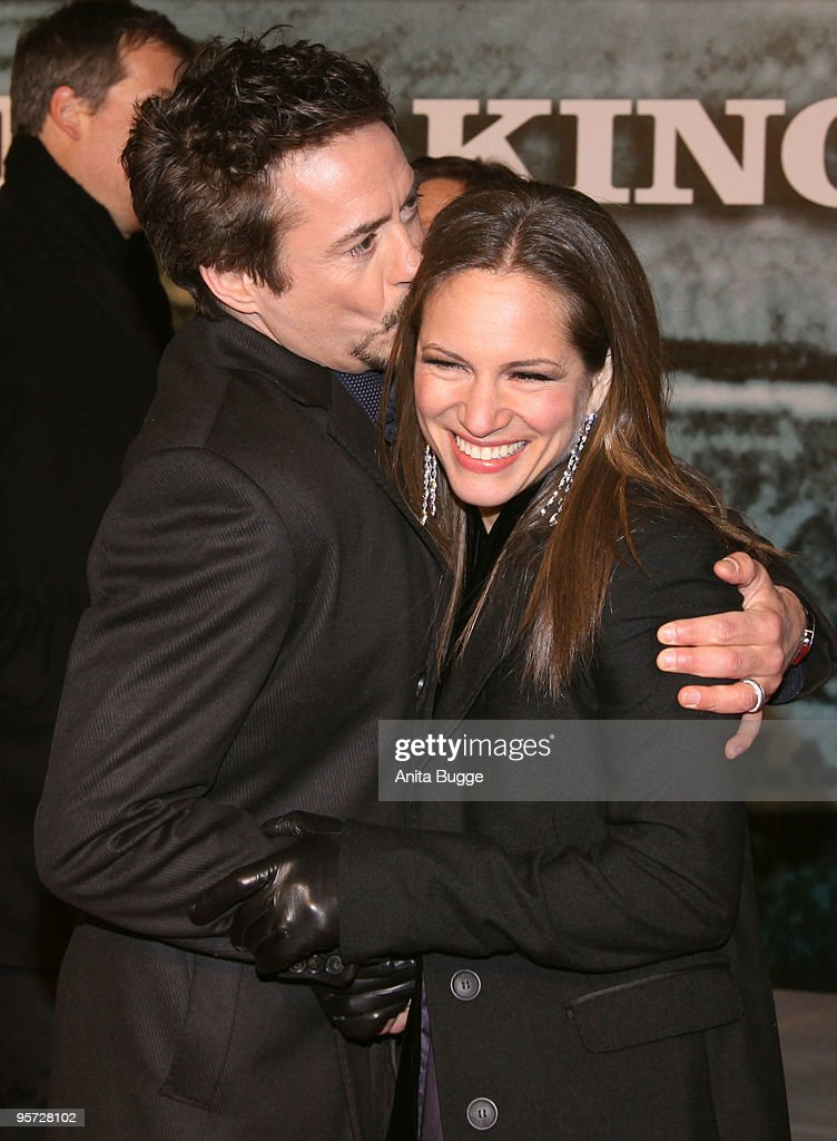 Actor Robert Downey Jr. and his wife Susan Downey attend the 'Sherlock Holmes' German Premiere at the CineStar movie theater on January 12, 2010 in Berlin, Germany.