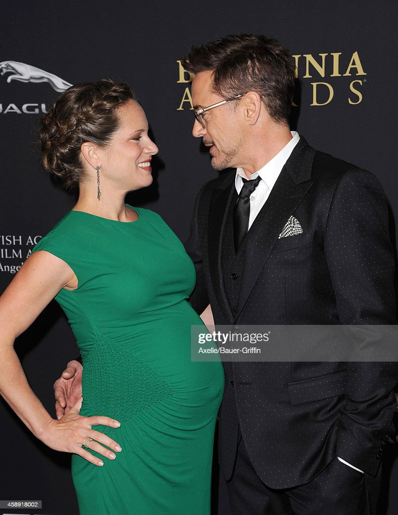 Actor Robert Downey Jr. (R) and producer Susan Downey arrive at the BAFTA Los Angeles Jaguar Britannia Awards at The Beverly Hilton Hotel on October 30, 2014 in Beverly Hills, California.