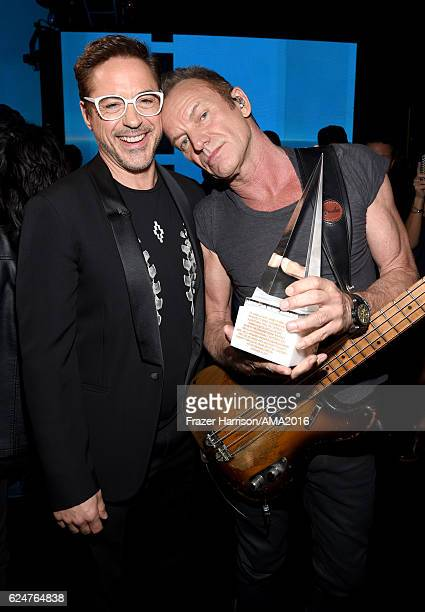 Actor Robert Downey Jr and singersongwriter Sting attend the 2016 American Music Awards at Microsoft Theater on November 20 2016 in Los Angeles...