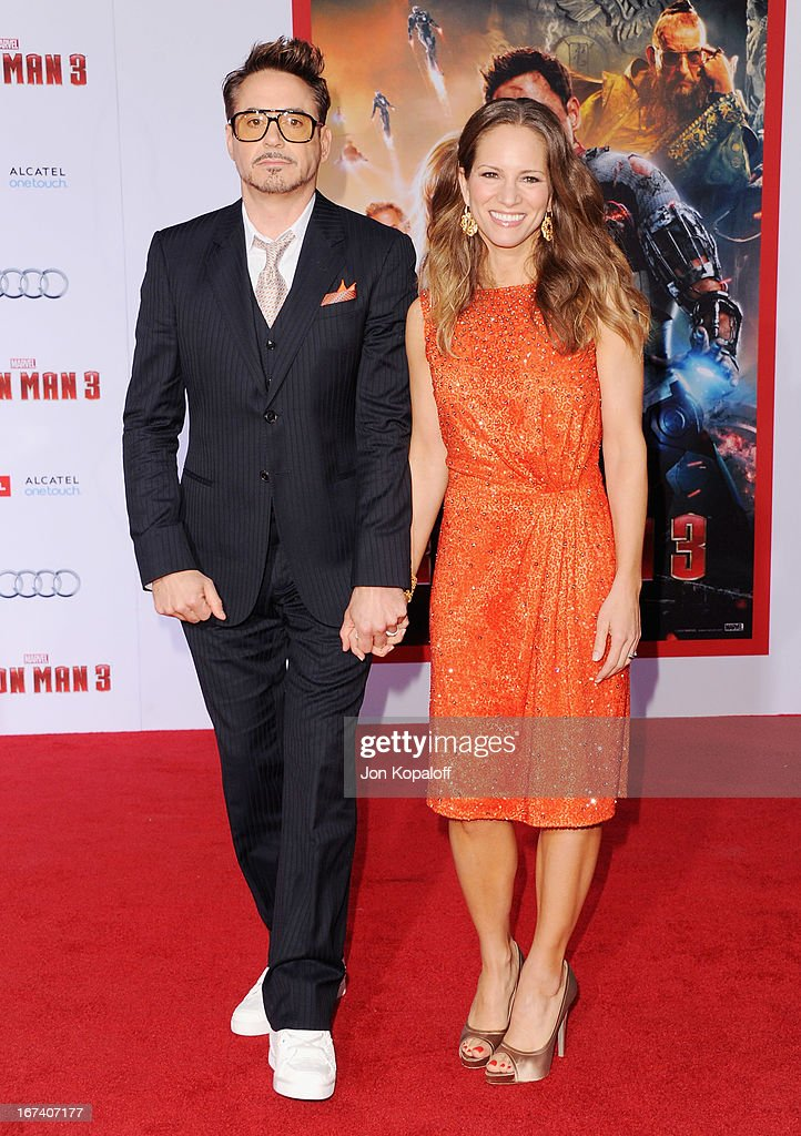 Actor Robert Downey Jr. and wife producer Susan Downey arrive at the Los Angeles Premiere 'Iron Man 3' at the El Capitan Theatre on April 24, 2013 in Hollywood, California.