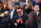 US actor Robert Downey Jr arrives for the premier of his latest film 'Iron Man 3' in Leicester Square in central London on April 18 2013 AFP...