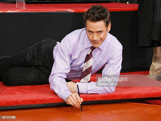 Actor Robert Downey Jr attends his hand and footprint ceremony held in conjunction with the film 'Sherlock Holmes' held at Grauman's Chinese Theatre...