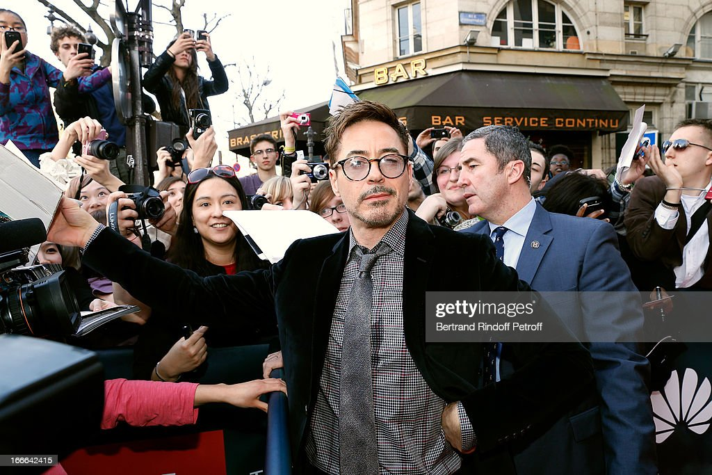 Actor <a gi-track='captionPersonalityLinkClicked' href=/galleries/search?phrase=Robert+Downey+Jr.&family=editorial&specificpeople=204137 ng-click='$event.stopPropagation()'>Robert Downey Jr.</a> attends 'Iron Man 3' movie premiere, held at Le Grand Rex on April 14, 2013 in Paris, France.