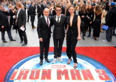 US actor Robert Downey Jr British actress Rebecca Hall and British actor Ben Kingsley pose for pictures on the red carpet as they arrive for the...