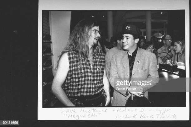 Actor Robert Downey Jr chatting w Dave Mustaine fr the rock group Megadeth at the Reebok party for Dem supporters during the wk of the Dem Natl...