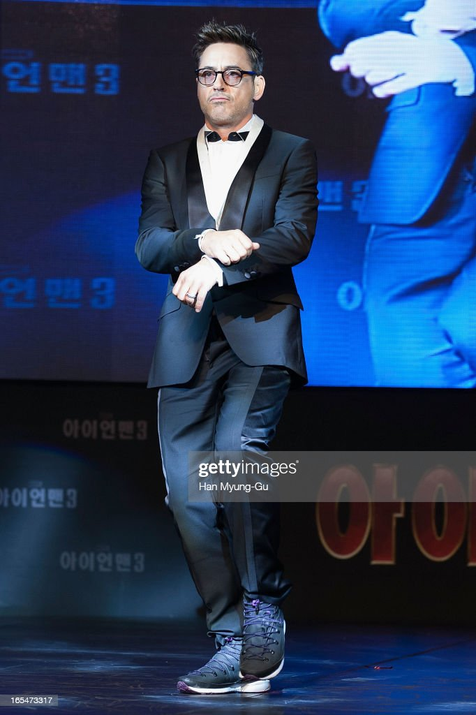 Actor Robert Downey Jr. dances to a song by South Korean rapper Psy during the 'Iron Man 3' South Korea Premiere at Times Square on April 4, 2013 in Seoul, South Korea. Robert Downey Jr. is visiting South Korea to promote his recent film 'Iron Man 3' which will be released on April 25 in South Korea.
