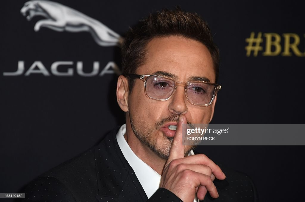 Actor Robert Downey Jr. gestures as he arrives at the BAFTA Los Angeles Jaguar Britannia Awards, October 30, 2014 at The Beverly Hilton Hotel in Beverly Hills, California.