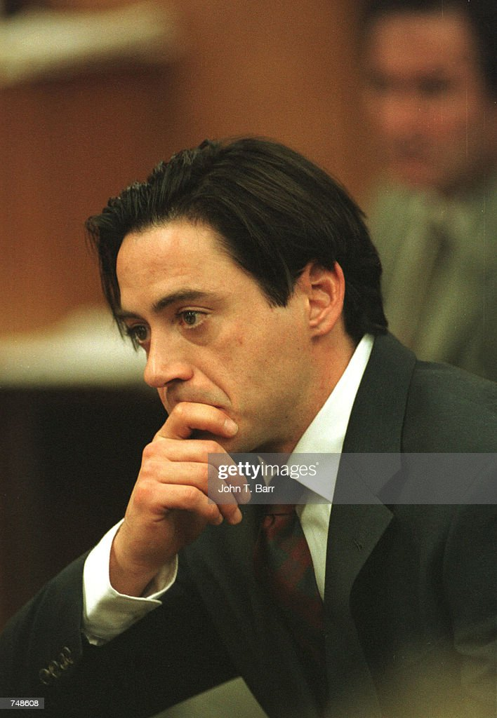 Actor Robert Downey Jr. listens as he is ordered to be sentenced for jail time after being charged for cocaine and speed possession following a judge's decision inside a Malibu courtroom December 8, 1997 in Malibu, CA. Three years later, at about the same time of the month, a source close to the actor said December 5, 2000 that Robert Downey Jr. faces a court hearing later this month on felony drug charges and was hospitalized over the weekend for treatment of depression.