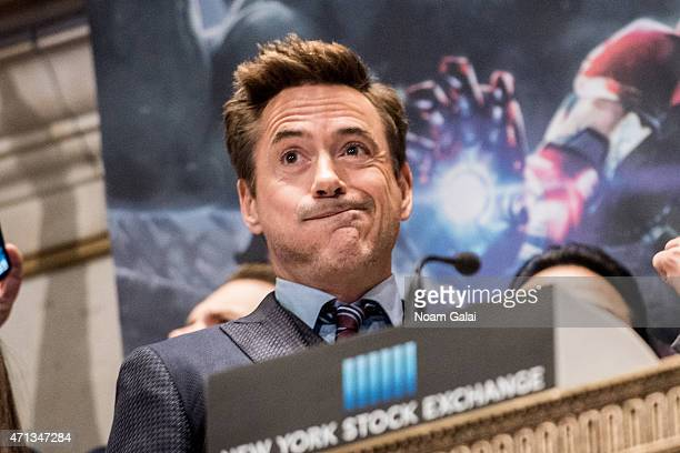 Actor Robert Downey Jr rings the NYSE opening bell at New York Stock Exchange on April 27 2015 in New York City