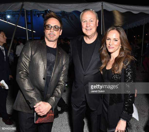 Actor Robert Downey Jr Robert Wilson and Susan Nicole Downey attend The 24th Annual Watermill Center Summer Benefit Auction at The Watermill Center...