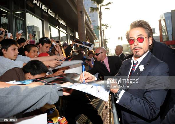 Actor Robert Downey Jr signs autographs as he arrives at the world wide premiere of 'Iron Man 2' Premiere held at the El Capitan Theatre on April 26...