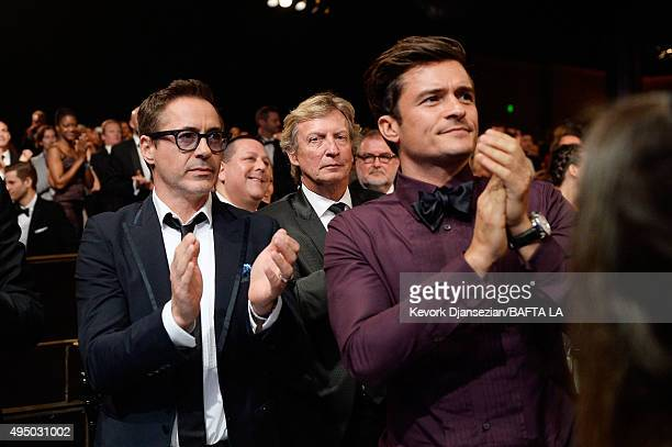 Actor Robert Downey Jr TV personality Nigel Lythgoe and honoree Orlando Bloom attend the 2015 Jaguar Land Rover British Academy Britannia Awards...