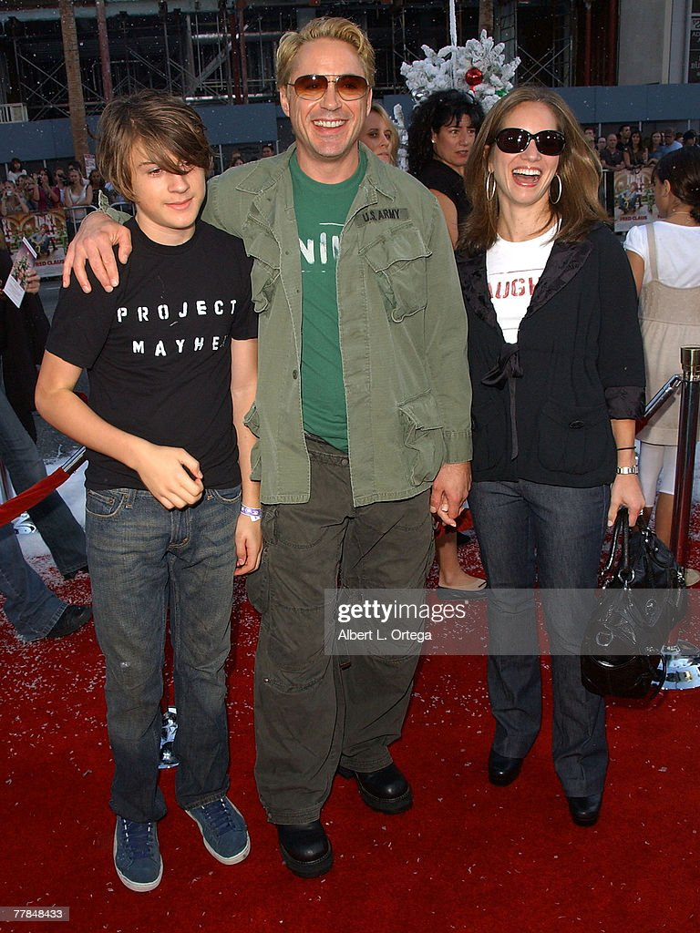 Actor Robert Downey Jr wife/producer Susan Levin and son Indio arrive at the premiere of Warner Bros and Silver Pictures' 'Fred Claus' held at...