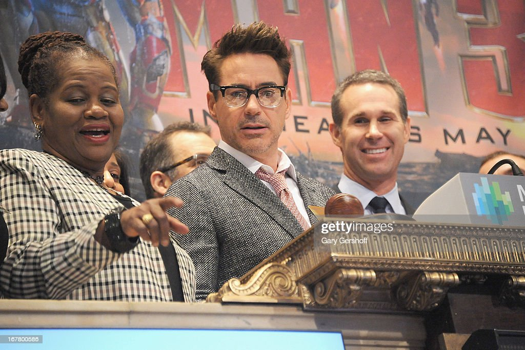 Actor Robert Downey (C) Jr.rings the opening bell in celebration of 'Iron Man 3' at the New York Stock Exchange on April 30, 2013 in New York City.