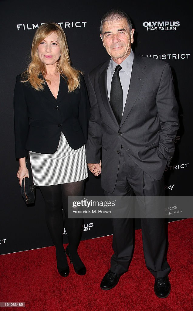 Actor Robert Forster (R) and his guest attend the Premiere of FilmDistrict's 'Olympus Has Fallen' at the ArcLight Cinemas Cinerama Dome on March 18, 2013 in Hollywood, California.