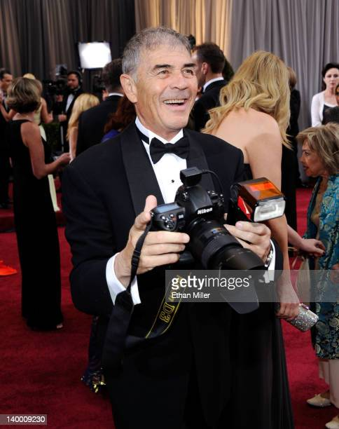 Actor Robert Forster uses a photographer's camera as he arrives at the 84th Annual Academy Awards held at the Hollywood Highland Center on February...
