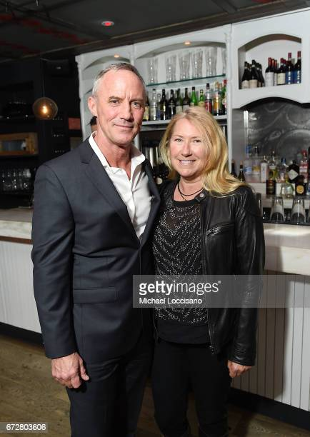 Actor Robert John Burke and wife attend a cocktail party at Bocca di Bacco Chelsea before the HBO Documentary screening of 'I Am Evidence' on April...