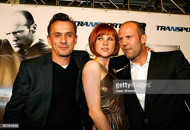 Actor Robert Knepper actress Natalya Rudakova and actor Jason Statham arrive at Planet Hollywood Resort Casino's Transporter 3 premiere on November...