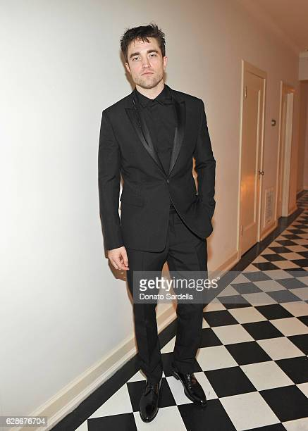Actor Robert Pattinson attends a private dinner hosted by GQ and Dior Homme in celebration of the 2016 GQ Men of The Year party at Chateau Marmont on...