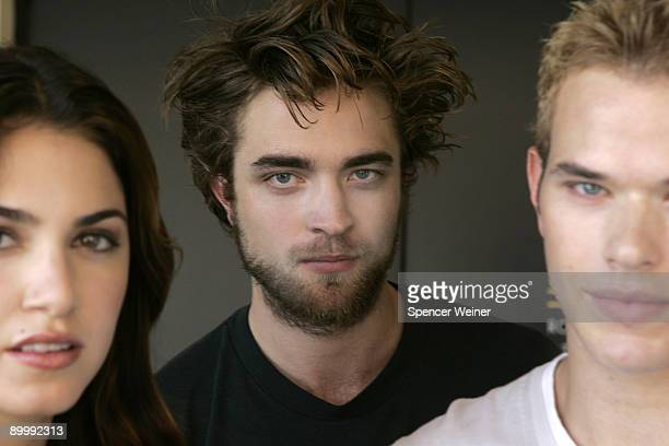 Actor Robert Pattinson poses for a portrait with actress Nikki Reed left and Kellan Lutz right in Los Angeles on October 8 2008 for the Los Angeles...