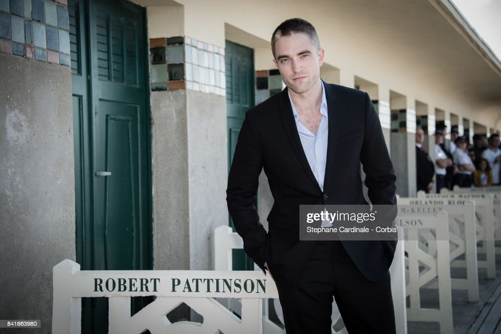 Actor Robert Pattinson poses in front of his dedicated beach locker room on the Promenade des Planches during the 43rd Deauville American Film Festival on September 2, 2017 in Deauville, France.