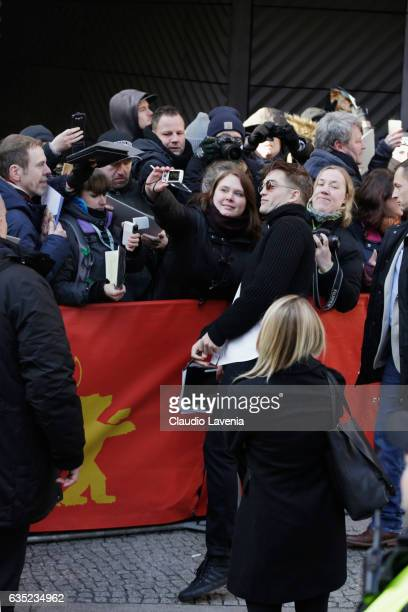 Actor Robert Pattinson signs autographs before the 'The Lost City of Z' photo call during the 67th Berlinale International Film Festival Berlin at...