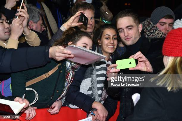 Actor Robert Pattinson takes a selfie with fans at the 'The Lost City of Z' premiere during the 67th Berlinale International Film Festival Berlin at...