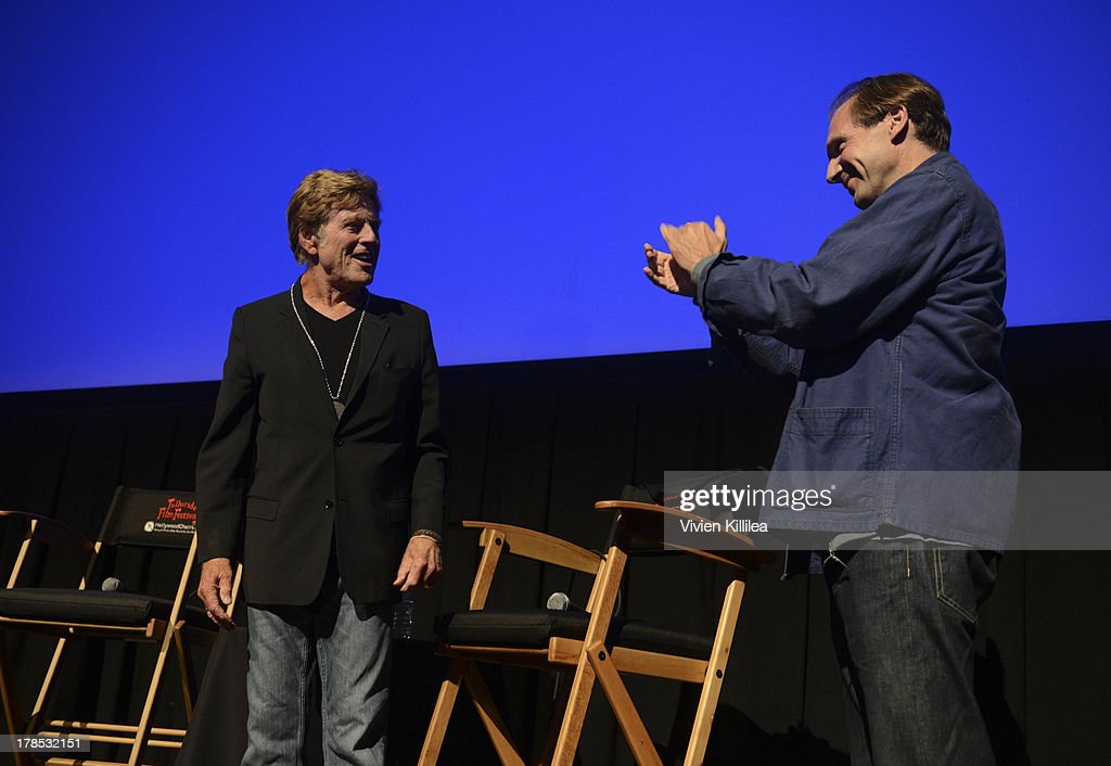 Actor <a gi-track='captionPersonalityLinkClicked' href=/galleries/search?phrase=Robert+Redford&family=editorial&specificpeople=202897 ng-click='$event.stopPropagation()'>Robert Redford</a> accepts his tribute award from actor <a gi-track='captionPersonalityLinkClicked' href=/galleries/search?phrase=Ralph+Fiennes&family=editorial&specificpeople=206461 ng-click='$event.stopPropagation()'>Ralph Fiennes</a> on day 1 of the 2013 Telluride Film Festival on August 29, 2013 in Telluride, Colorado.