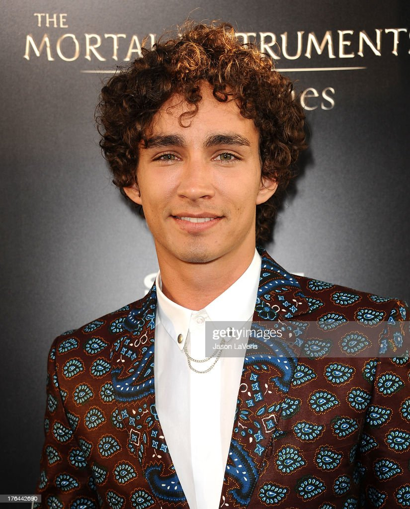 Actor Robert Sheehan attend the premiere of 'The Mortal Instruments: City Of Bones' at ArcLight Cinemas Cinerama Dome on August 12, 2013 in Hollywood, California.