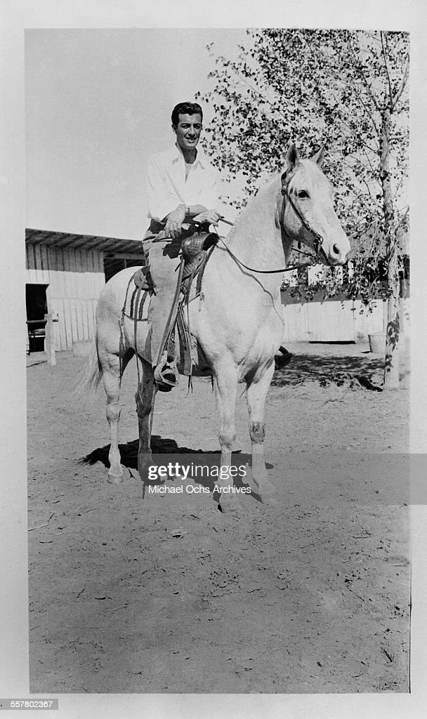 Actor <a gi-track='captionPersonalityLinkClicked' href=/galleries/search?phrase=Robert+Taylor+-+American+Actor&family=editorial&specificpeople=5411922 ng-click='$event.stopPropagation()'>Robert Taylor</a> poses on his horse in Los Angeles, California.