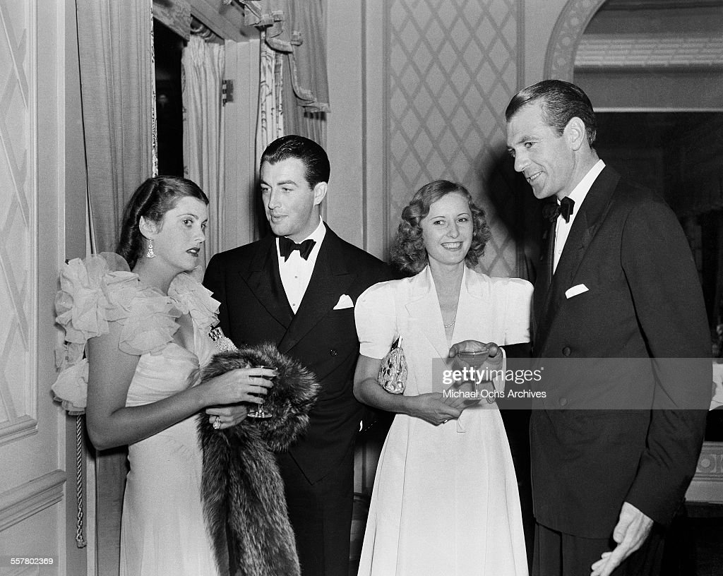 Actor <a gi-track='captionPersonalityLinkClicked' href=/galleries/search?phrase=Robert+Taylor+-+American+Actor&family=editorial&specificpeople=5411922 ng-click='$event.stopPropagation()'>Robert Taylor</a> (L) talks with Veronica Cooper as actress <a gi-track='captionPersonalityLinkClicked' href=/galleries/search?phrase=Barbara+Stanwyck&family=editorial&specificpeople=90352 ng-click='$event.stopPropagation()'>Barbara Stanwyck</a> talks with actor <a gi-track='captionPersonalityLinkClicked' href=/galleries/search?phrase=Gary+Cooper&family=editorial&specificpeople=93434 ng-click='$event.stopPropagation()'>Gary Cooper</a> during an event in Los Angeles, California.