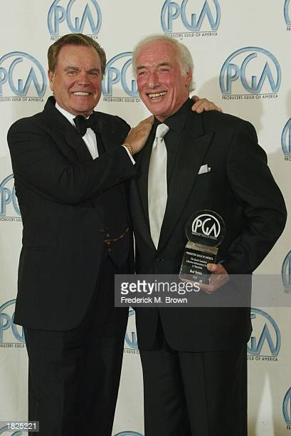 Actor Robert Wagner and director Bud Yorkin pose backstage at the14th Annual Producers Guild Awards at the Century Plaza Hotel on March 2 2003 in Los...