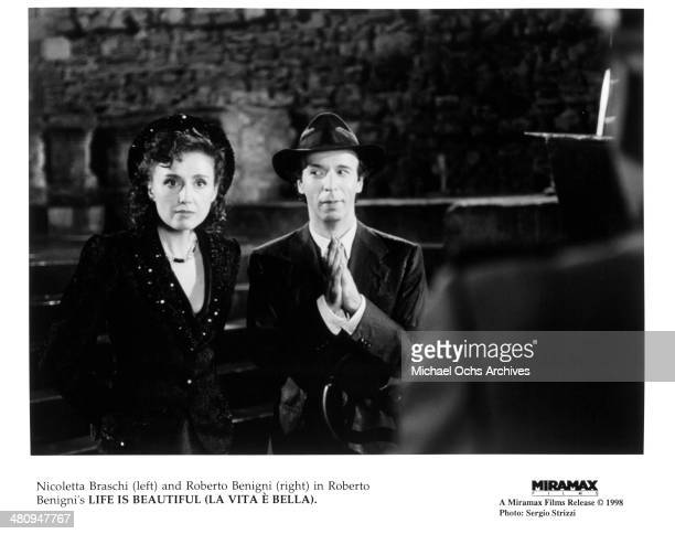 Actor Roberto Benigni and actress Nicoletta Braschi in a scene from the Miramax movie 'Life Is Beautiful' circa 1997