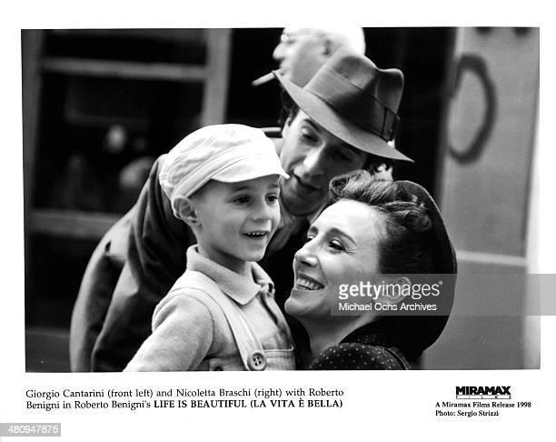 Actor Roberto Benigni and Giorgio Cantarini and actress Nicoletta Braschi in a scene from the Miramax movie 'Life Is Beautiful' circa 1997