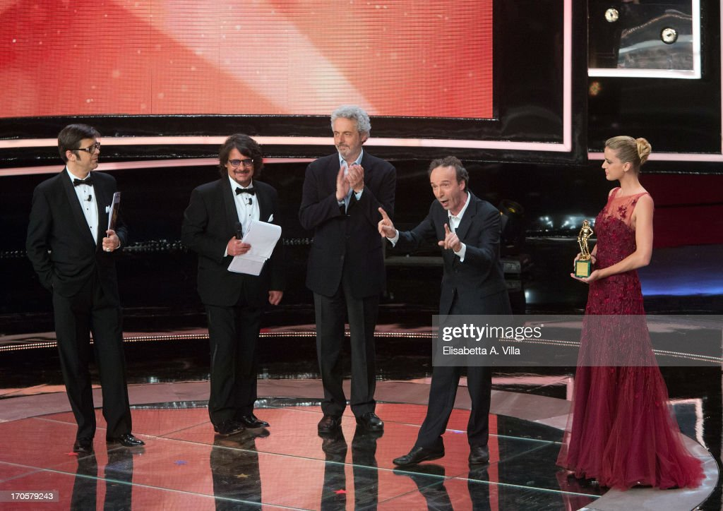 Actor <a gi-track='captionPersonalityLinkClicked' href=/galleries/search?phrase=Roberto+Benigni&family=editorial&specificpeople=217583 ng-click='$event.stopPropagation()'>Roberto Benigni</a> (2nd R) appears on stage during the 2013 Premi David di Donatello Ceremony Awards at Dear RAI Studios on June 14, 2013 in Rome, Italy.
