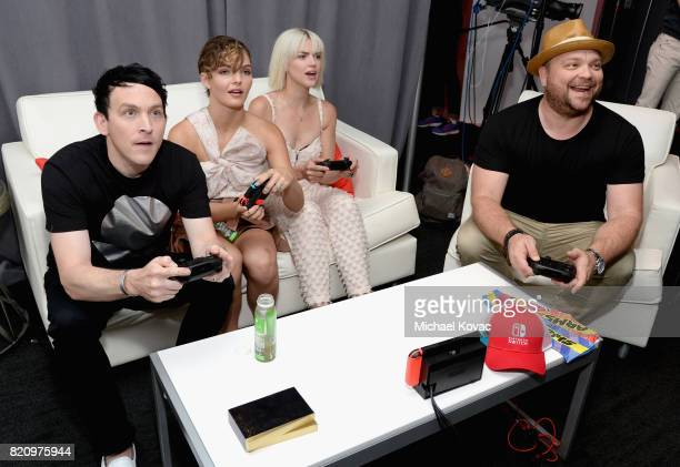 Actor Robin Lord Taylor actress Camren Bicondova actress Erin Richards and Drew Powell of the FOX series 'Gotham' stopped by Nintendo at the TV...