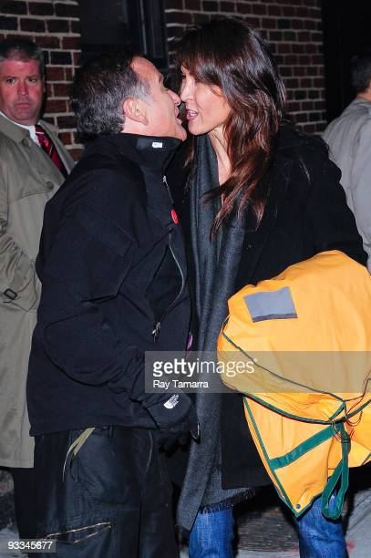 Actor Robin Williams and guest leave the 'Late Show With David Letterman' at the Ed Sullivan Theater on November 23 2009 in New York City
