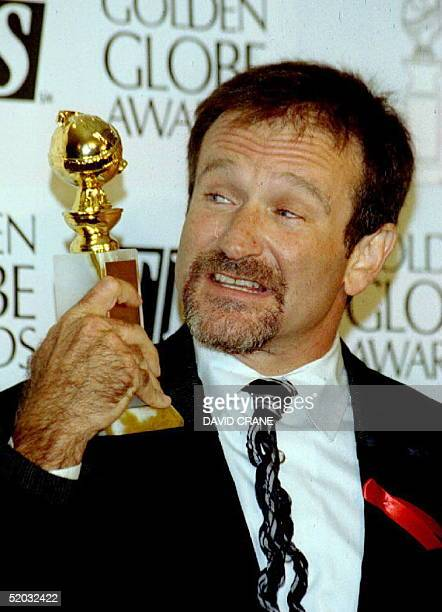 S actor Robin Williams holds his Golden Globe after winning for best actor in a comedy for his role in 'Mrs Doubtfire' 22 January 1994 The movie also...