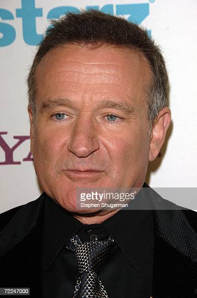 Actor Robin Williams poses with his Lifetime Achievement award in the press room at The Hollywood Film Festival 10th Annual Hollywood Awards Gala...