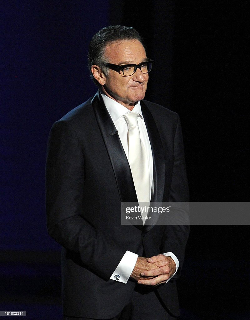 Actor <a gi-track='captionPersonalityLinkClicked' href=/galleries/search?phrase=Robin+Williams&family=editorial&specificpeople=174322 ng-click='$event.stopPropagation()'>Robin Williams</a> speaks onstage during the 65th Annual Primetime Emmy Awards held at Nokia Theatre L.A. Live on September 22, 2013 in Los Angeles, California.
