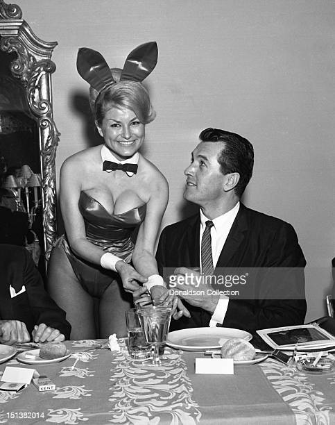 Actor Rock Hudson autographs the cuff of a Playboy Bunny at a dinner for the Motion Picture Pioneers Association at the Playboy Club on November 19...