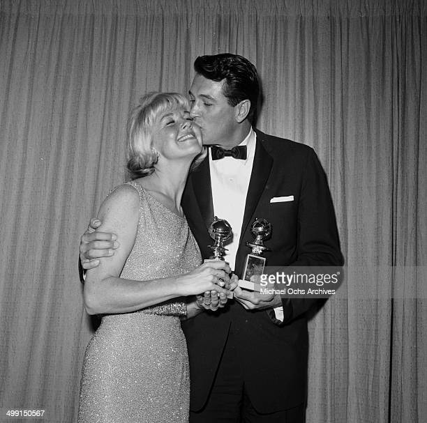 Actor Rock Hudson with actress Doris Day pose with their Golden Globe awards in Los AngelesCalifornia
