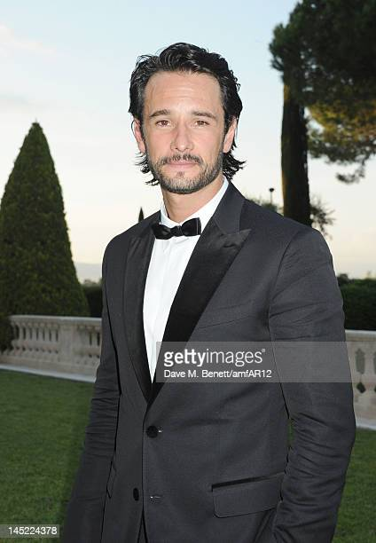 Actor Rodrigo Santoro attends the 2012 amfAR's Cinema Against AIDS during the 65th Annual Cannes Film Festival at Hotel Du Cap on May 24 2012 in Cap...