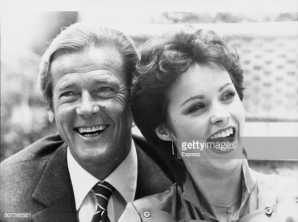 Actor Roger Moore and singer Sheena Easton posing together to promote the film 'For Your Eyes Only' and the song of the same name 1981