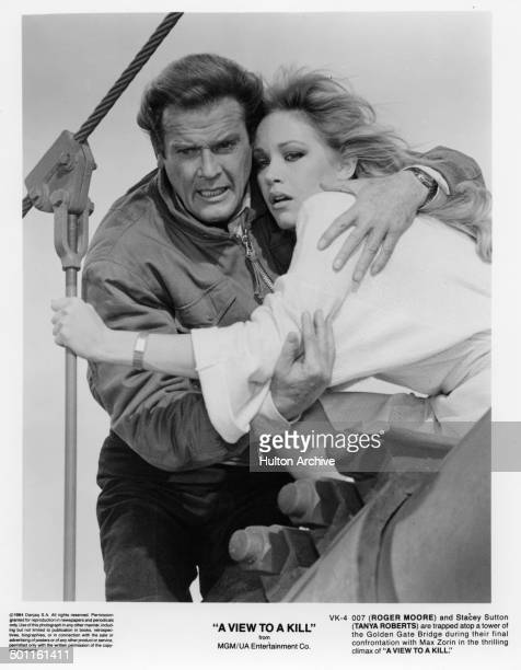 Actor Roger Moore grabs into Tanya Roberts in a scene of the MGM/UA movie 'A View to a Kill' circa 1984