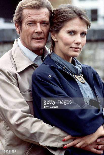 Actor Roger Moore left and Actress Maud Adams stars of the latest James Bond film 'Octopussy' pose for a photograph during filming on set at the Nene...