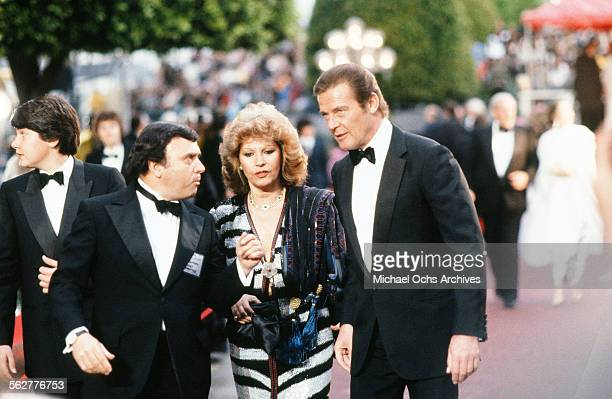 Actor Roger Moore with his wife Luisa Mattioli arrive to the 54th Academy Awards at Dorothy Chandler Pavilion in Los AngelesCalifornia