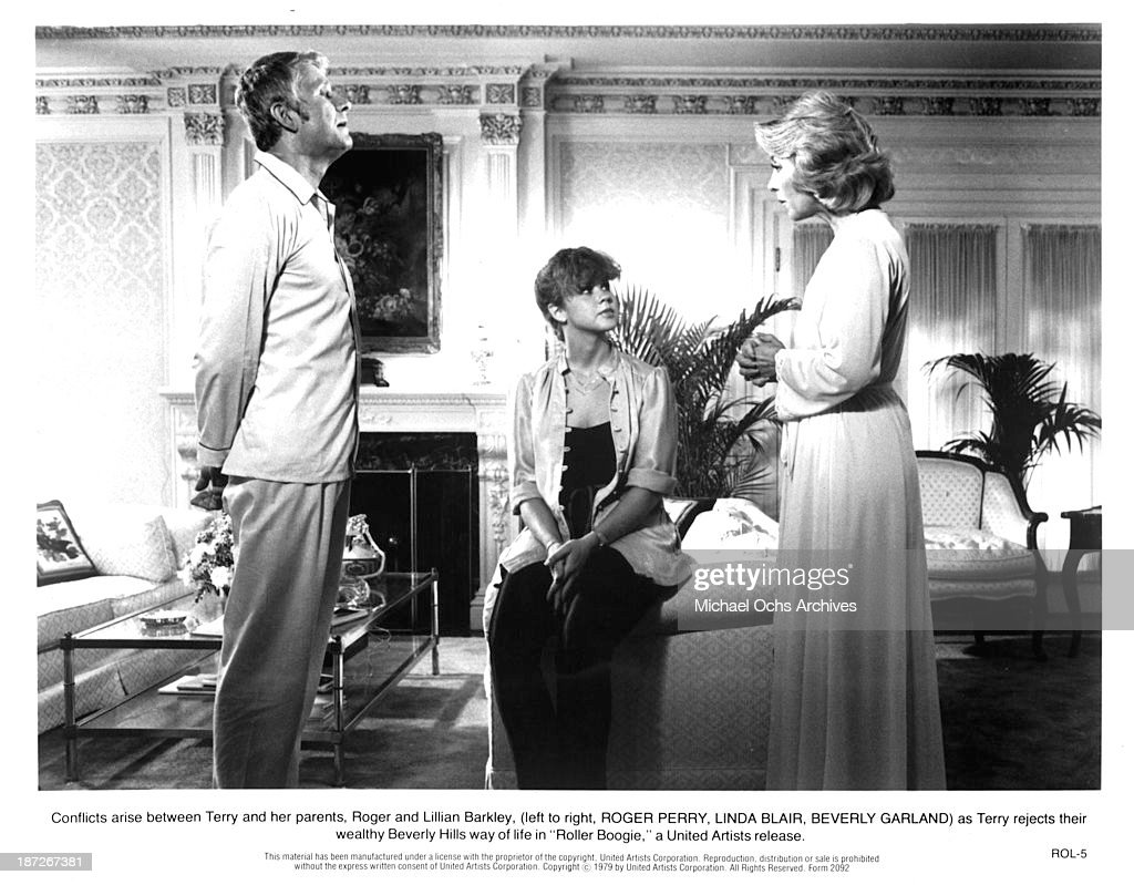 Actor Roger Perry actresses Linda Blair and Beverly Garland on set of the United Artist movie 'Roller Boogie' in 1979
