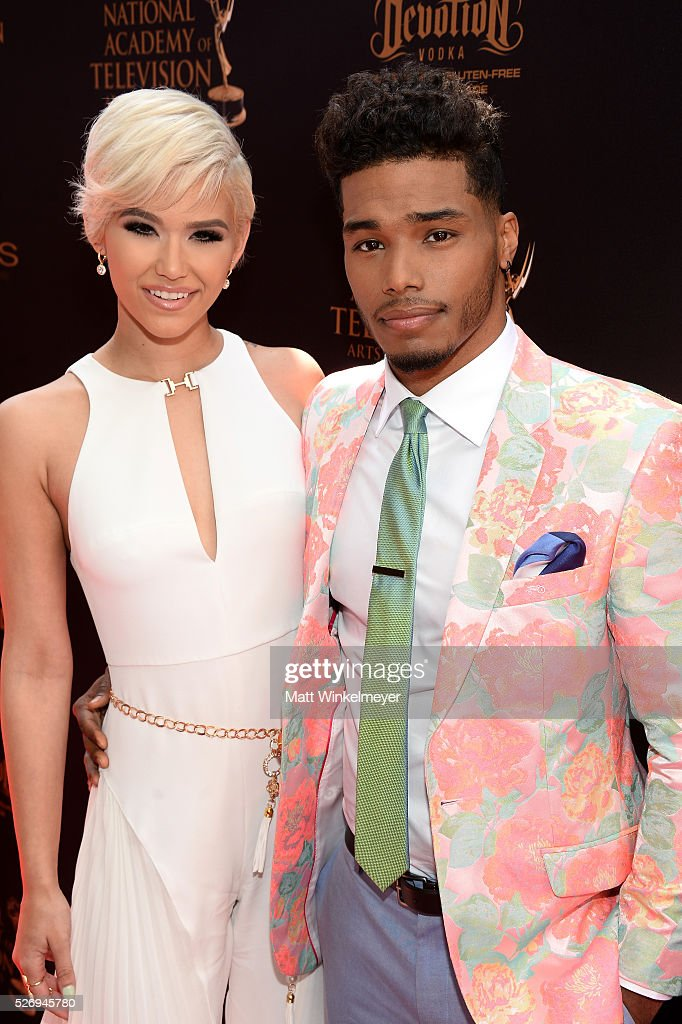 Actor Rome Flynn (R) and model Camia Marie walk the red carpet at the 43rd Annual Daytime Emmy Awards at the Westin Bonaventure Hotel on May 1, 2016 in Los Angeles, California.