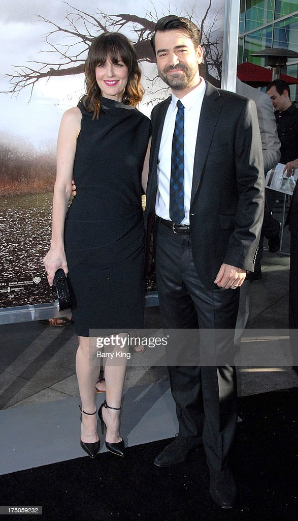 Actor <a gi-track='captionPersonalityLinkClicked' href=/galleries/search?phrase=Ron+Livingston&family=editorial&specificpeople=213878 ng-click='$event.stopPropagation()'>Ron Livingston</a> (R) and wife <a gi-track='captionPersonalityLinkClicked' href=/galleries/search?phrase=Rosemarie+DeWitt&family=editorial&specificpeople=630212 ng-click='$event.stopPropagation()'>Rosemarie DeWitt</a> arrive at the Los Angeles Premiere 'The Conjuring' at ArcLight Cinemas Cinerama Dome on July 15, 2013 in Hollywood, California.